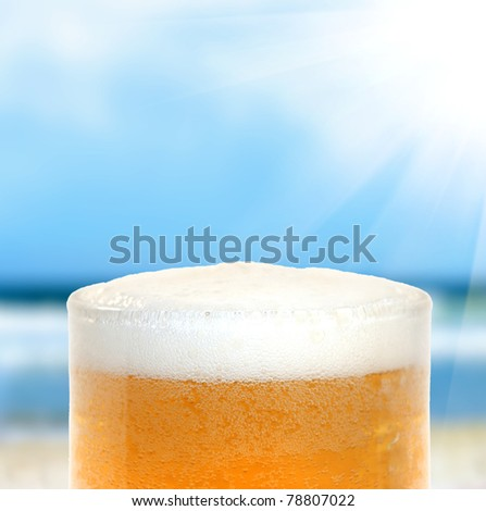 Beer on a beach - stock photo