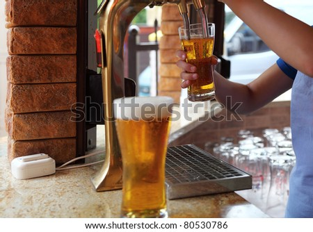 Beer on bar counter - stock photo