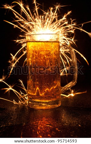 beer on black background - stock photo