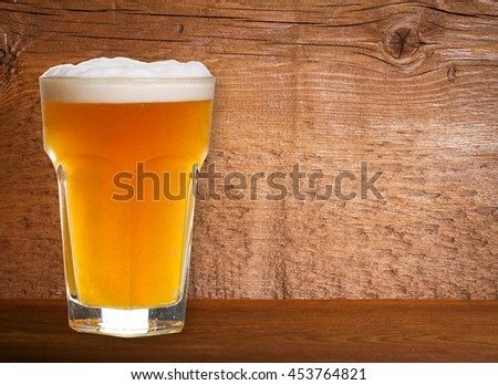 Beer on Old Wooden Shabby Background Close Up
