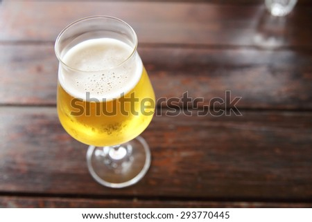 beer on wood background - stock photo