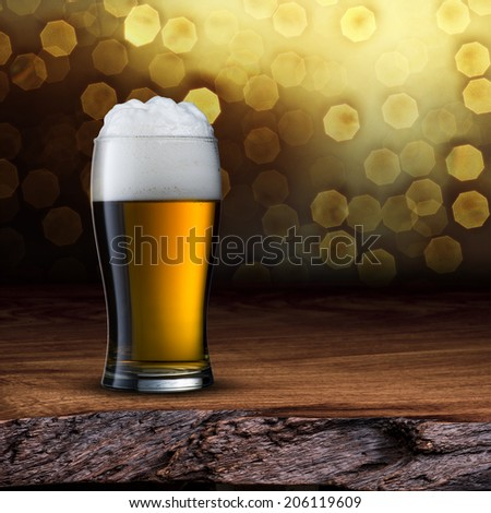 Beer on wood table with light bokeh background