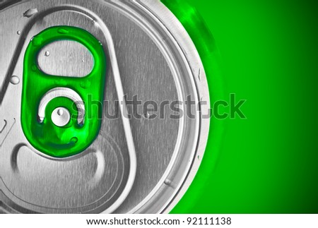 Beer or soft drink can on a green background - stock photo