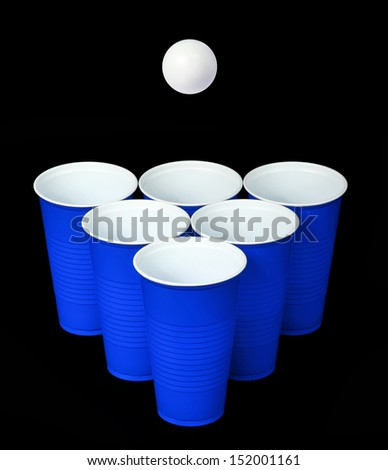 Beer pong. Blue plastic cups and ping pong ball over black background - stock photo