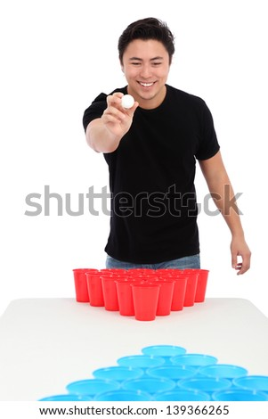 Beer pong player wearing a black t-shirt throwing a ball. White background. - stock photo