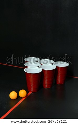 Beer Pong with two orange ping pong balls - stock photo