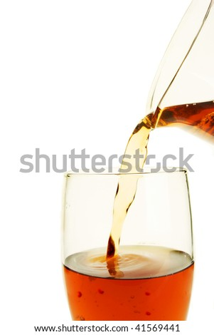 Beer pouring from a jug into a glass