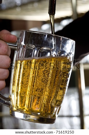 beer pouring from a tap - stock photo