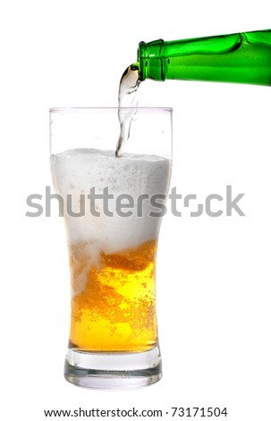 Beer pouring from green bottle into glass isolated on white - stock photo