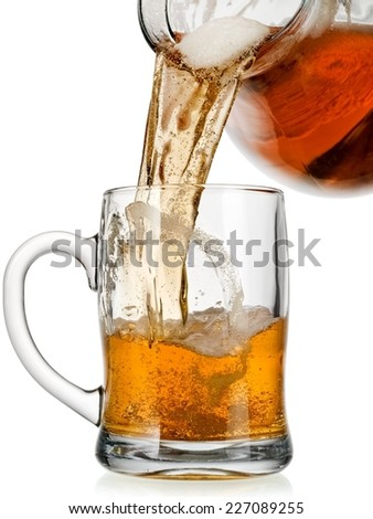 Beer pouring in a mug