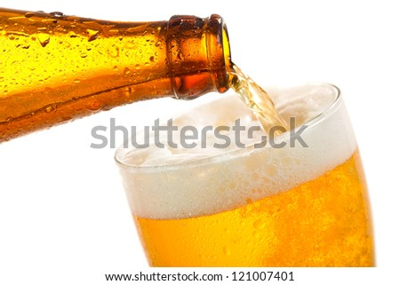 Beer pouring into glass on a white background - stock photo