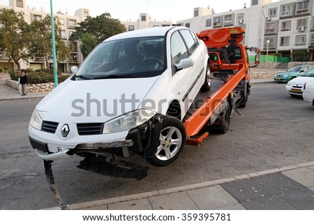 BEER SHEVA, ISRAEL - NOVEMBER 27, 2011: Evacuation of the car after the accident with a broken front part