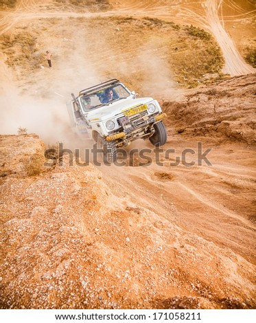 BEER-SHEVA/ISRAEL - 23 NOVEMBER 2013: Jeep is trying to call the mountain desert . 23 november Israel. - stock photo