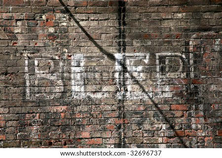 Beer sign on an old brick wall - stock photo