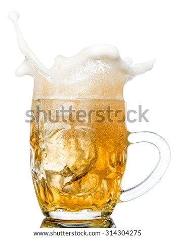 Beer splash in glasses isolated on white. - stock photo