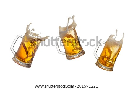 Beer splashing in glasses isolated on white - stock photo