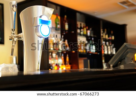 Beer tap in a bar. - stock photo