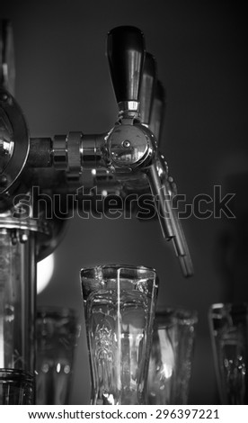 Beer tap in the bar Black and White - stock photo