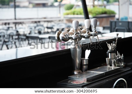 Beer tap on the Bar - stock photo