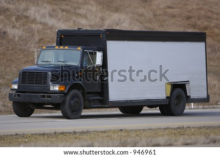 Beer Truck on the highway with white side for message or product - stock photo