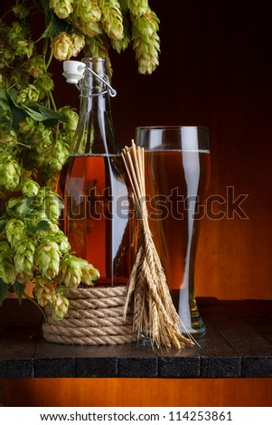 Beer with brewery hop and wheat - stock photo