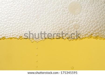 Beer with foam - stock photo