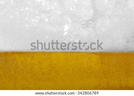 Beer with foam and bubbles as background