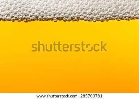 Beer with foam in transparent glass. Abstract Macro. Minimalism
