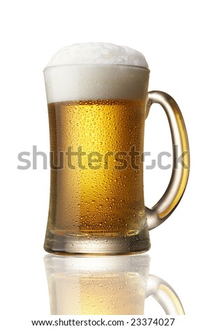 beer with foam, water drops on mug - stock photo
