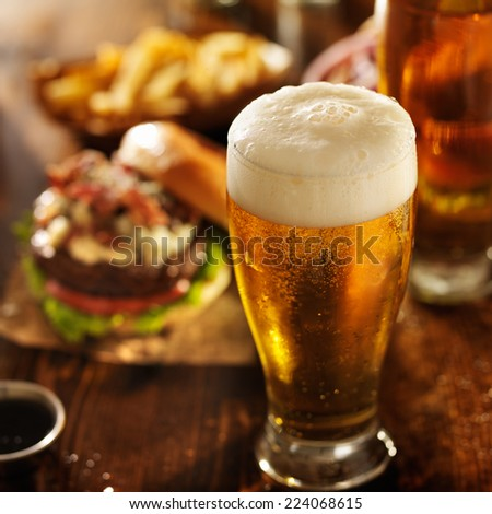 beer with hamburgers on restaurant table - stock photo