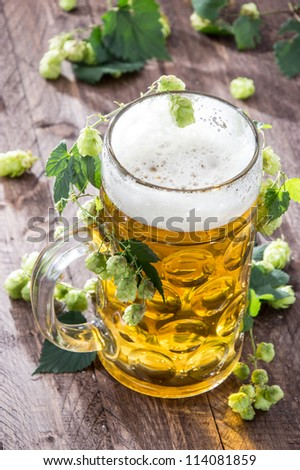 Beer with Hops on wood - stock photo