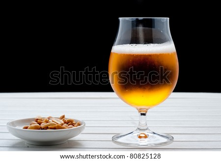 Beer with peanuts - stock photo