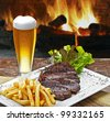 Beer with roast beef and potatoes - stock photo