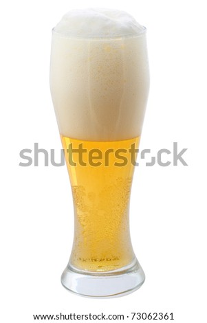 Beer with the foam in a glass isolated on white background