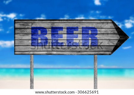 Beer wooden sign with on a beach background - stock photo
