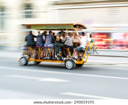 Beerbike on the the street of the city. Intentional motion blur - stock photo