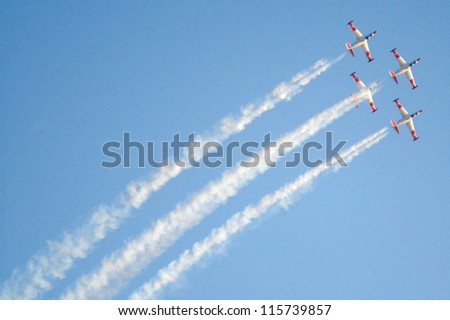 BEERSHEBA, ISRAEL - JUNE 28 2008: Acrobat air show of Fouga CM.170 Magister takes place during a graduation ceremony of Israeli Air Force pilots over the Hatzerim Air Force base.