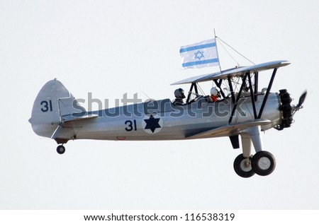 BEERSHEBA-JUNE 28: Avia BH-21 plane fly above Hatzerim Air Force base near Beersheba, Israel on June 28, 2007.It was a robust biplane during the period between World War I and World War II. - stock photo