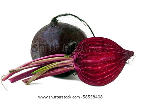 Beet purple vegetable with light shadow on white background - stock photo