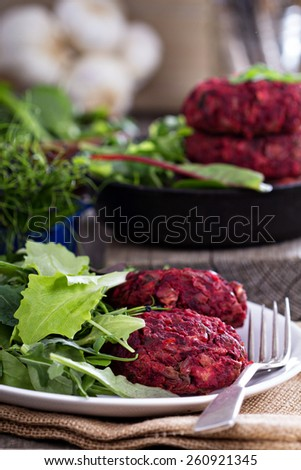 Beet root and red bean vegan burgers with salad - stock photo
