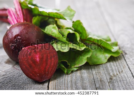 beet roots and green leaves - stock photo