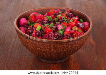 Beet salad in bowl on table close-up