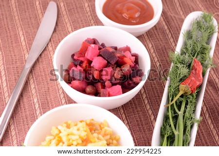Beet salad Vinaigrette and fried rice in a white plate - stock photo
