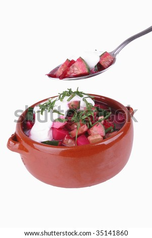 beet soup and sour cream over white background