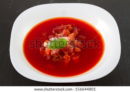 beet soup in white plate