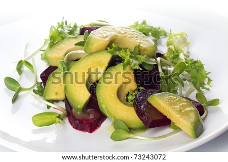 Beetroot and avocado salad with lemon and Fresh sunflower sprouts - stock photo