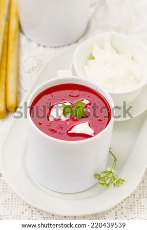 beetroot  and tomato creamy  diet soup in white bowl. selective focus