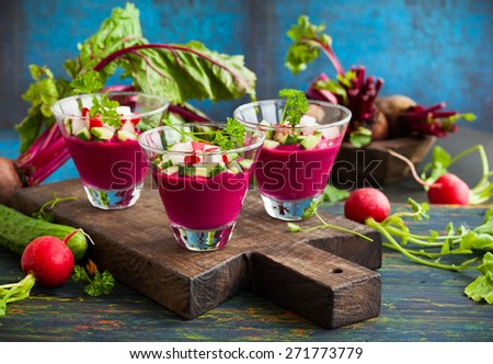 Beetroot gazpacho soup with cucumber and radish in  glasses - stock photo