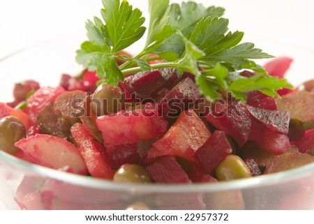 beetroot salad decorated with parsley on white ground