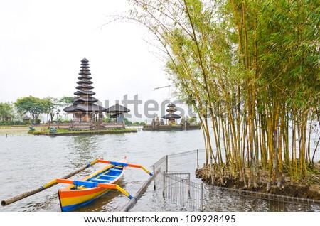 Befog lake and Pura Ulun Danu Temple on Bratan lake, Bali Indonesia - stock photo